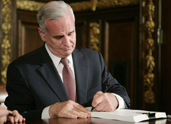 "Governor Mark Dayton signs into law the ""Suppressor Bill"""